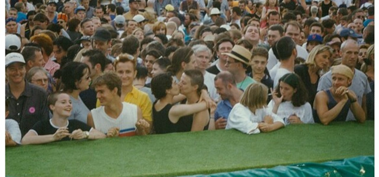 Midsumma Carnival 1996 by Richard Israel and 1997 by Virginia Selleck: the audience with those at the front leaning on the fake lawn covered catwalk